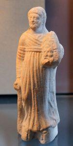 Figura griega de terracota representando un actor de tragedia